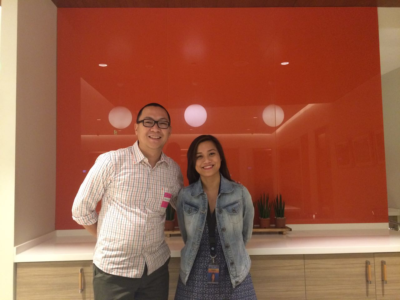 Marv de Leon with Dani Gil of Globe myBusiness at the Globe office.