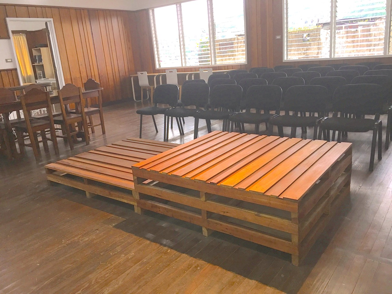 A wooden stage for town halls and speaking engagements.